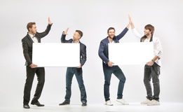 Group of friends giving a high-fives. Group of cheerful friends giving a high-fives Stock Photo