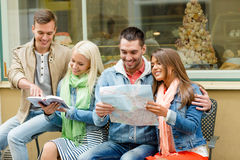 Group of friends with guide and map exploring town Royalty Free Stock Photography