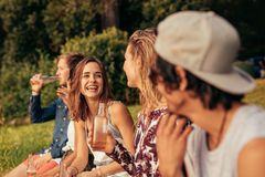 Group of friends hanging out at the lake Stock Images