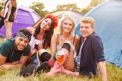 Group of friends hanging out at a music festival campsite Stock Photo