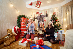 Group of friends in a happy Christmas gifts, laughing, having fu Royalty Free Stock Photography