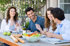 Group Of Friends Having Dinner. Group Of Happy Friends Having Dinner At Patio royalty free stock images
