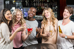 Group of friends having a drink Royalty Free Stock Photo