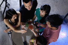 A group of friends having drinks in nightclub Royalty Free Stock Photography