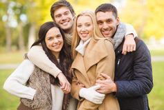 Group of friends having fun in autumn park Stock Images