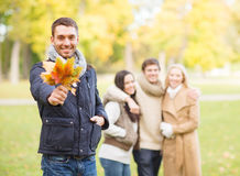 Group of friends having fun in autumn park Royalty Free Stock Photo