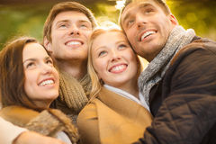 Group of friends having fun in autumn park Stock Photography