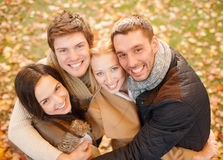 Group of friends having fun in autumn park Royalty Free Stock Photos