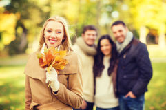 Group of friends having fun in autumn park Stock Photo