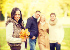 Group of friends having fun in autumn park Stock Photos