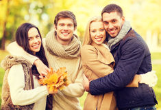 Group of friends having fun in autumn park Royalty Free Stock Images