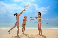 Group of friends having fun at the beach. A group of Asian young woman having fun at the beach Stock Image