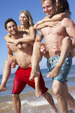 Group Of Friends Having Fun On Beach Holiday Together Stock Images