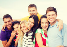 Group of friends having fun on the beach. Summer, holidays, vacation and happiness concept - group of friends having fun on the beach royalty free stock photography