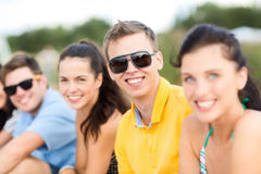 Group of friends having fun on the beach Stock Photos