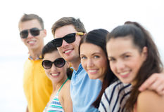 Group of friends having fun on the beach Stock Photo