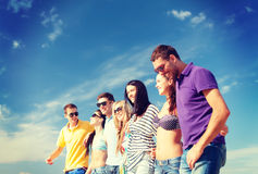 Group of friends having fun on the beach Stock Image