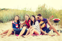 Group of friends having fun on the beach Royalty Free Stock Image