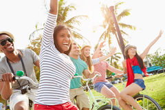 Group Of Friends Having Fun On Bicycle Ride Stock Images