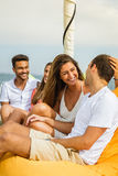 Group of friends having fun in boat in river Royalty Free Stock Photos