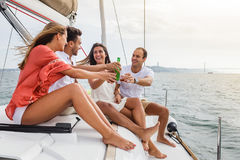 Group of friends having fun in boat in river Stock Images