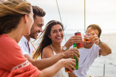 Group of friends having fun in boat in river Stock Photography