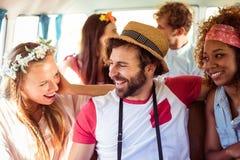 Group of friends having fun in campervan. Group of happy friends having fun in campervan stock image