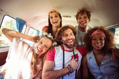 Group of friends having fun in campervan. Group of happy friends having fun in campervan royalty free stock photography