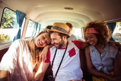 Group of friends having fun in campervan. Group of happy friends having fun in campervan royalty free stock photo