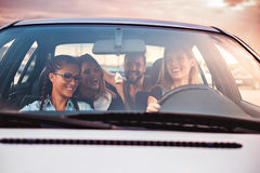 Group of friends having fun in the car. Sunset Royalty Free Stock Images