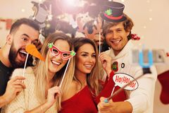 Group of friends having fun during Christmas Stock Images