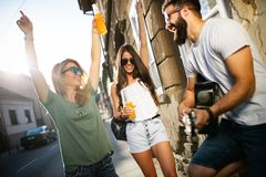 Group of friends having fun and hanging out outdoors. At summer royalty free stock images