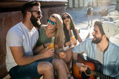 Group of friends having fun and hanging out outdoors stock images