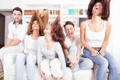 Group of friends having fun at home. Acting silly Stock Photography