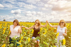 Group of friends having fun outdoors. In a field Stock Photo