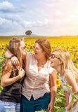 Group of friends having fun outdoors. In a field Royalty Free Stock Images
