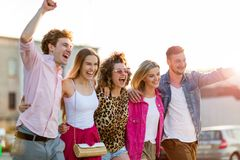 Group of friends having fun outdoors. Smiling Royalty Free Stock Photography