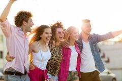 Group of friends having fun outdoors. Smiling Royalty Free Stock Photo