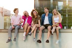 Group of friends having fun outdoors. Smiling Royalty Free Stock Image