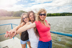 Group of friends having fun outdoors on a lake. Group of best friends having fun outdoors on a lake Royalty Free Stock Photo