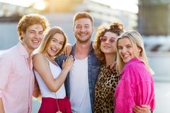 Group of friends having fun outdoors. Smiling Stock Image