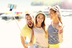 Group of friends having fun outdoors in summer Stock Photo