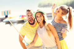 Group of friends having fun outdoors in summer Stock Images