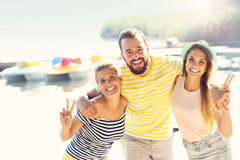 Group of friends having fun outdoors in summer Stock Photos