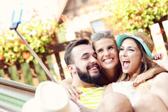 Group of friends having fun outdoors in summer Stock Image
