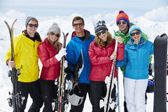 Group Of Friends Having Fun On Ski Holiday In Mountains Stock Photos