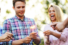 Group of friends having fun with sparklers Stock Images