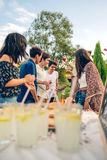 Group of friends having fun in a summer barbecue Stock Image