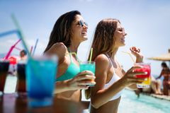 Group of friends having fun on summer vacation. Lifestyle, friendship, travel and holidays concept. Group of friends having fun on summer vacation and drinking royalty free stock images