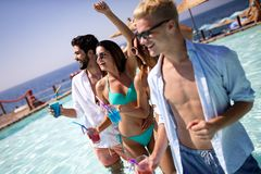 Group of friends having fun on summer vacation. Lifestyle, friendship, travel and holidays concept. Group of friends having fun on summer vacation and drinking stock photo